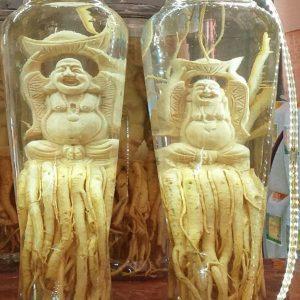 Di lặc đội vàng - Đinh lăng điêu khắc - Bình 7 lít