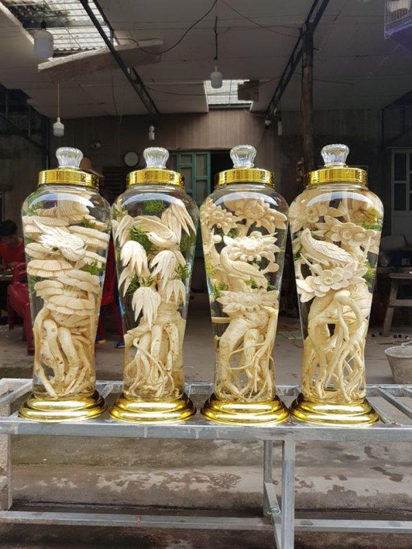 Đôi én đậu cành mai - Đinh lăng điêu khắc - Bình 7 lít
